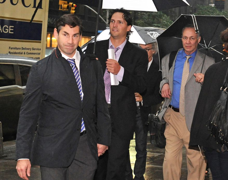 Matthew Schneider, left, special assistant to NHL Players Association executive director Donald Fehr, Winnipeg Jets' Ron Hainsey, center,  and Steve Fehr, players union special counsel, arrive at NHL headquarters in New York, Friday, Sept. 28, 2012. With the clock ticking down to the start of the season, the NHL and its locked-out players are talking again. (AP Photo/ Louis Lanzano)