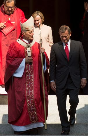 Cardinal Donald Wuerl (left), archbishop of Washington, and Chief Justice John G. Roberts Jr. walk out of the Cathedral of St. Matthew the Apostle after the annual Red Mass on Sunday, Sept. 30, 2012, in Washington. (Andrew Harnik/The Washington Times)