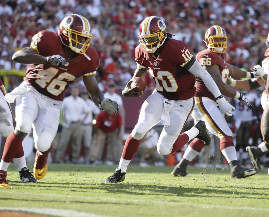 Washington Redskins quarterback Robert Griffin III (10) scores a touchdown during an NFL game between the Redskins and the Tampa Bay Buccaneers.  The Redskins defeated the Buccaneers 24-22 Sunday, Sept. 30, 2012, in Tampa, Fla.  (AP Photo/Margaret Bowles)