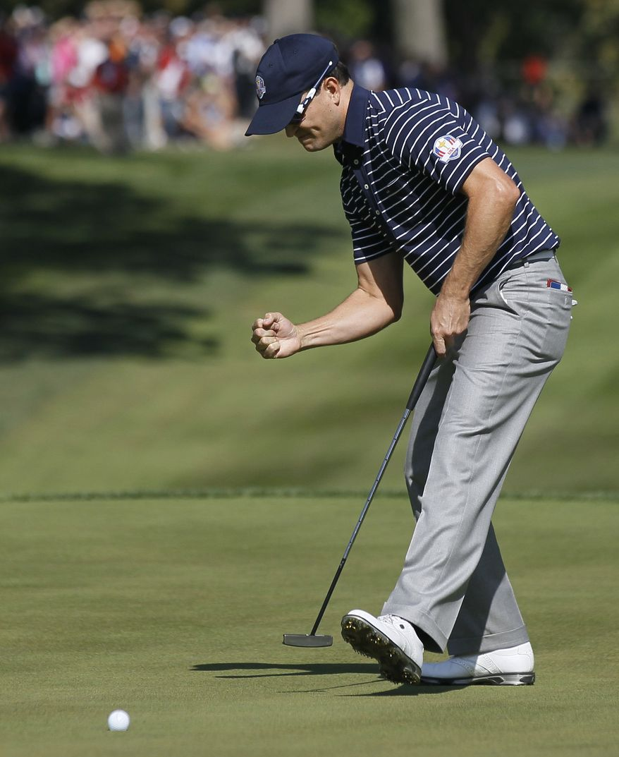 USA's Zach Johnson reacts after making a putt on the 14th hole during a foursomes match at the Ryder Cup PGA golf tournament Saturday, Sept. 29, 2012, at the Medinah Country Club in Medinah, Ill. (AP Photo/Charles Rex Arbogast)