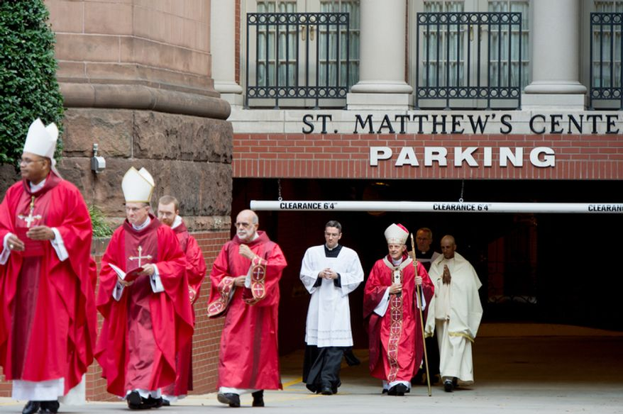Archbishop of Washington Cardinal Donald Wuerl, third from right, makes his way into Red Mass at Cathedral of St. Matthew the Apostle, Washington, D.C., Sunday, September 30, 2012. Red Mass, held annually in Washington, D.C. the day before the Supreme Court's new term opens is offered to invoke God's blessing and guidance on justices, judges, diplomats, attorneys and senior government officials. (Andrew Harnik/The Washington Times)