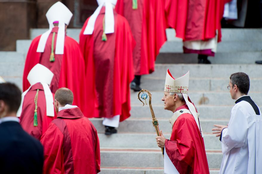 Archbishop of Washington Cardinal Donald Wuerl, second from right, makes his way into Red Mass at Cathedral of St. Matthew the Apostle. (Andrew Harnik/The Washington Times)