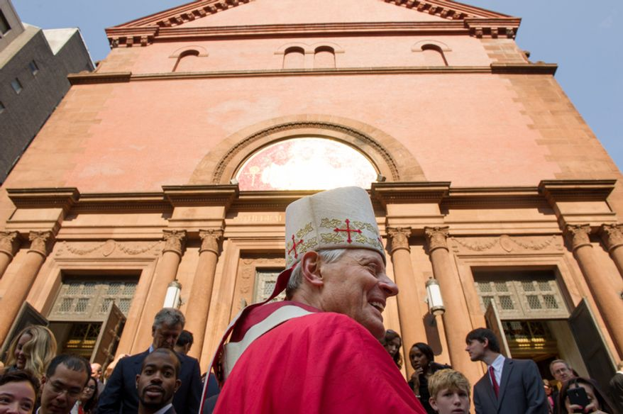 Archbishop of Washington Cardinal Donald Wuerl greets churchgoers following Red Mass at Cathedral of St. Matthew the Apostle. (Andrew Harnik/The Washington Times)