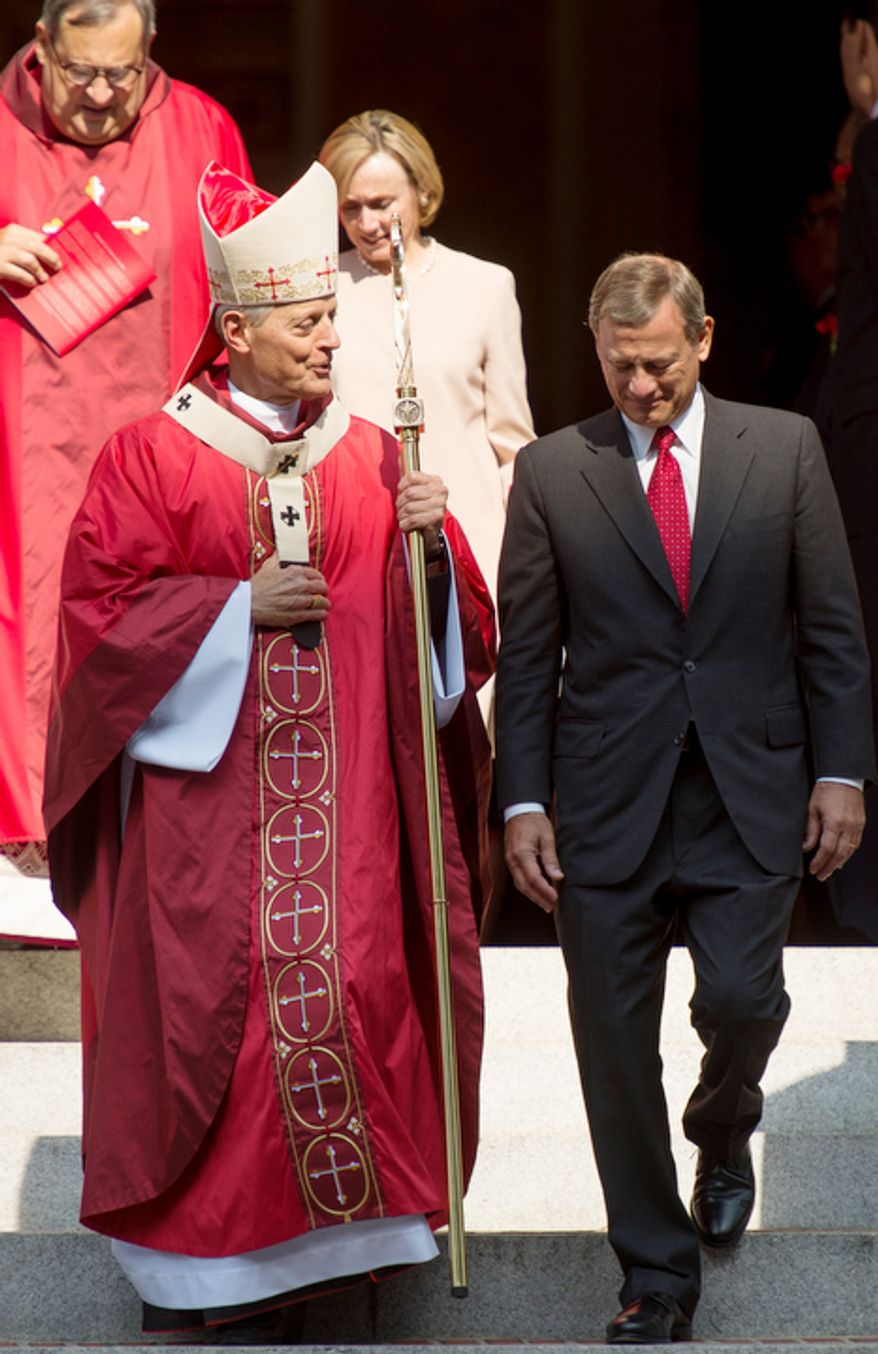 Archbishop of Washington Cardinal Donald Wuerl and Supreme Court Chief Justice John Roberts walk out of Red Mass at Cathedral of St. Matthew the Apostle. (Andrew Harnik/The Washington Times)