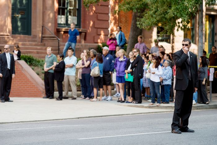 Onlookers watch as Red Mass ends at the Cathedral of St. Matthew the Apostle, Washington, D.C., Sunday, September 30, 2012. (Andrew Harnik/The Washington Times)