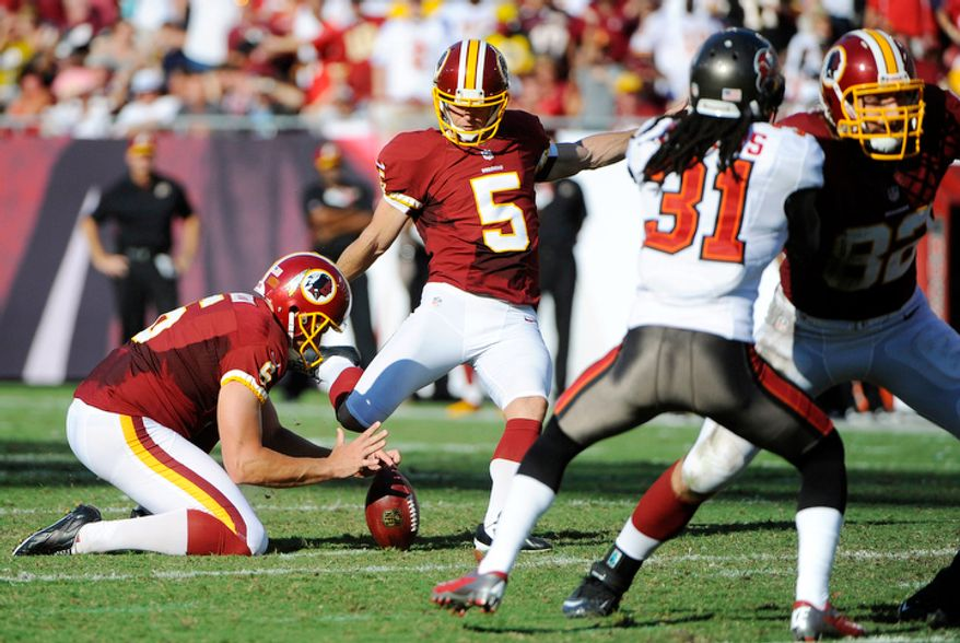 Washington Redskins kicker Billy Cundiff (5) kicks a field goal as Sav Rocca holds during the first quarter. (AP Photo/Brian Blanco)