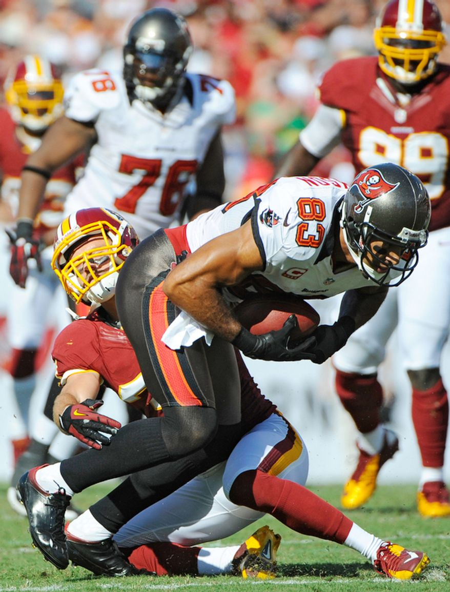 Tampa Bay Buccaneers wide receiver Vincent Jackson (83) is brought down by Washington Redskins strong safety Reed Doughty (37) during the first quarter. (AP Photo/Brian Blanco)