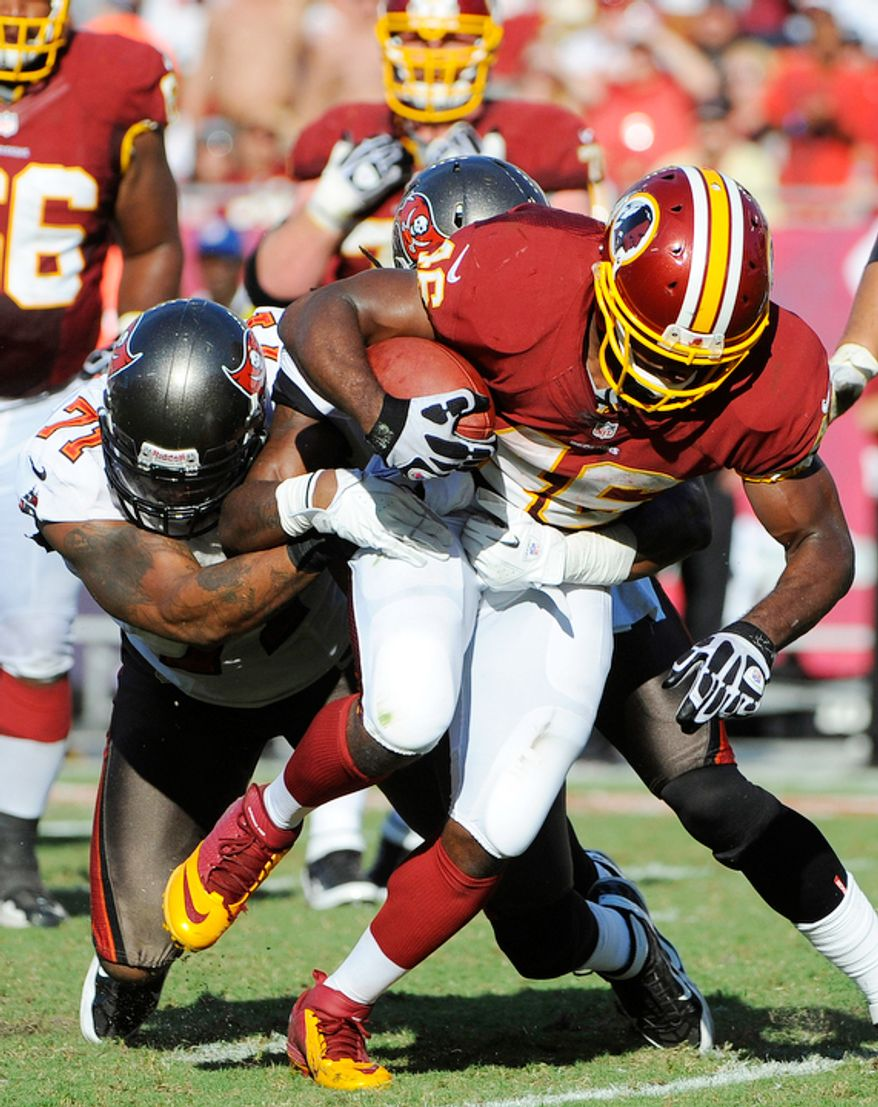 Washington Redskins running back Alfred Morris (46) is brought down by Tampa Bay Buccaneers defensive end Michael Bennett (71) during the first quarter. (AP Photo/Brian Blanco)