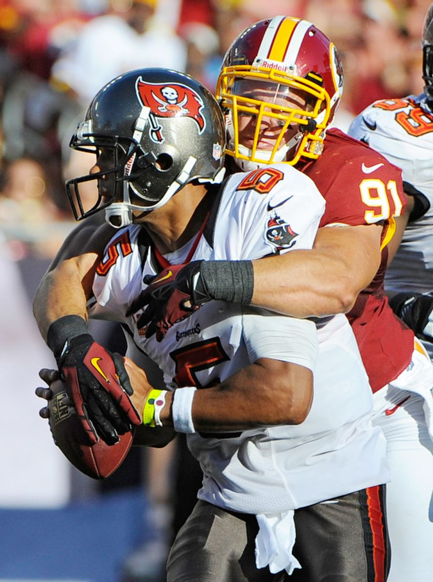 Washington Redskins outside linebacker Ryan Kerrigan (91) sacks Tampa Bay Buccaneers quarterback Josh Freeman (5) during the second quarter. (AP Photo/Brian Blanco)
