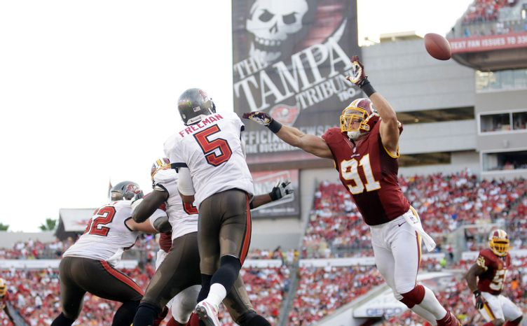 Washington Redskins outside linebacker Ryan Kerrigan (91) interrupts the pass by Tampa Bay Buccaneers quarterback Josh Freeman (5).   (AP Photo/Margaret Bowles)