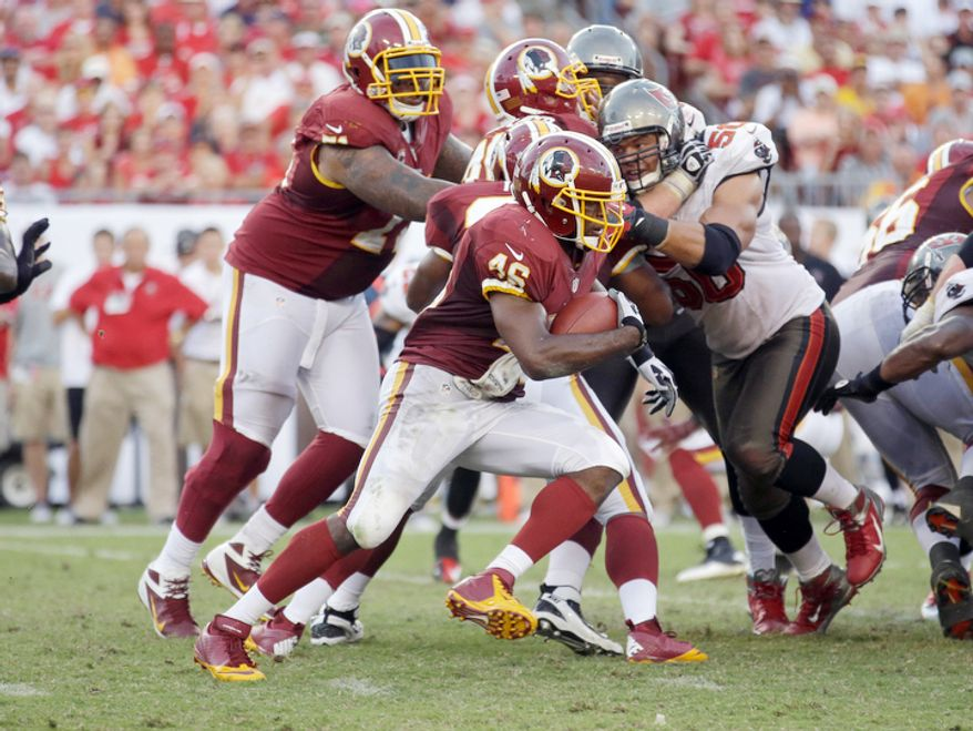 Washington Redskins running back Alfred Morris (46) finds a hole in the defensive line during an NFL game between the Redskins and the Tampa Bay Buccaneers.   (AP Photo/Margaret Bowles)