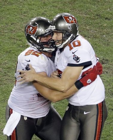 Tampa Bay Buccaneers kicker Connor Barth (10) and Tampa Bay Buccaneers guard Ted Larsen (62) celebrate a field goal that put the Bucs ahead late in the fourth quarter.  (AP Photo/Margaret Bowles)
