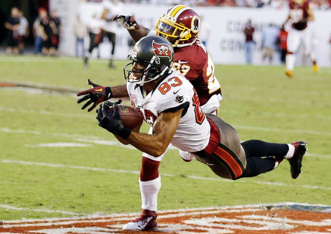 Tampa Bay Buccaneers wide receiver Vincent Jackson (83) pulls in a 54-yard reception in front of Washington Redskins cornerback DeAngelo Hall during the fourth quarter. (AP Photo/Chris O'Meara)