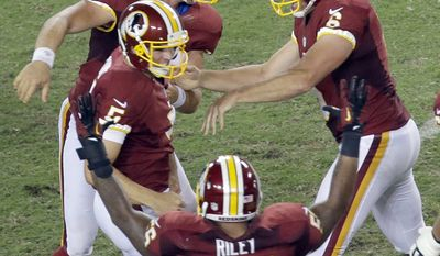 The Redskins celebrate with kicker Billy Cundiff after defeating the Buccaneers 24-22 Sunday, Sept. 30, 2012, in Tampa, Fla.  (AP Photo/Margaret Bowles)