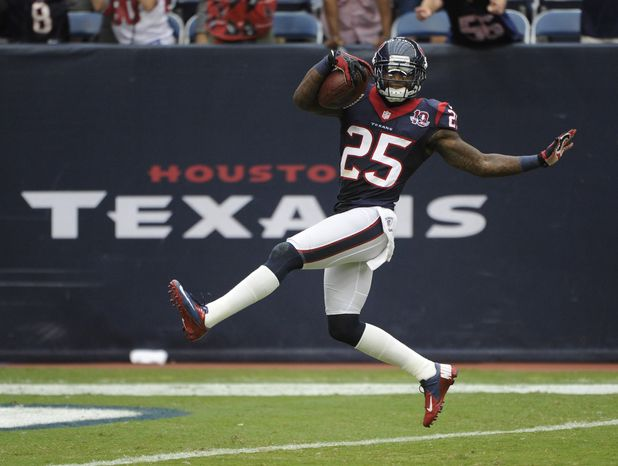 Houston Texans cornerback Kareem Jackson dances into the end zone for a touchdown after an interception during the fourth quarter of an NFL football game against the against the Tennessee Titans Sunday, Sept. 30, 2012, in Houston. (AP Photo/Dave Einsel)