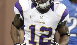 Minnesota Vikings wide receiver Percy Harvin (12) after returning a kickoff for a touchdown against the Detroit Lions to start their NFL football game Sunday, Sept. 30, 2012, in Detroit. (AP Photo/Duane Burleson)