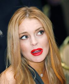 FILE - Lindsay Lohan at the 2012 White House Correspondents' Association Dinner in Washington, which she attended as a guest of Fox News Channel's Greta Van Susteren. (AP Photo/Haraz N. Ghanbari, File)