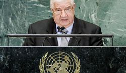 Syrian Foreign Minister Walid al-Moallem accuses the media, international aid groups and other external forces of attempting to destabilize his country. (Associated Press)