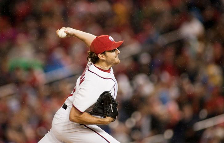 Washington Nationals starting pitcher John Lannan (31) pitches in the second inning. (Craig Bisacre/The Washington Times)