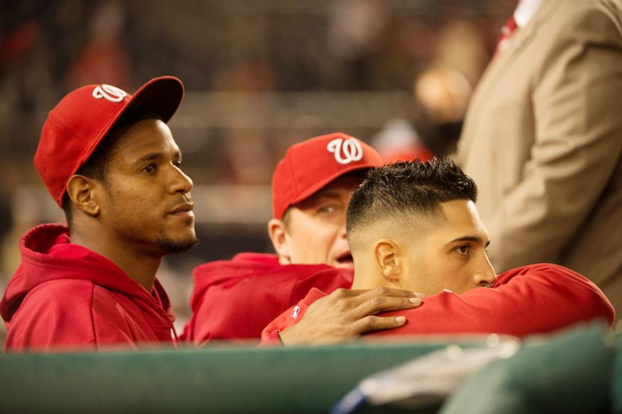 Washington Nationals starting pitcher Edwin Jackson (33), left, and Washington Nationals starting pitcher Gio Gonzalez (47), right, watch as the Washington Nationals play the Philadelphia Phillies at Nationals Park. (Andrew Harnik/The Washington Times)