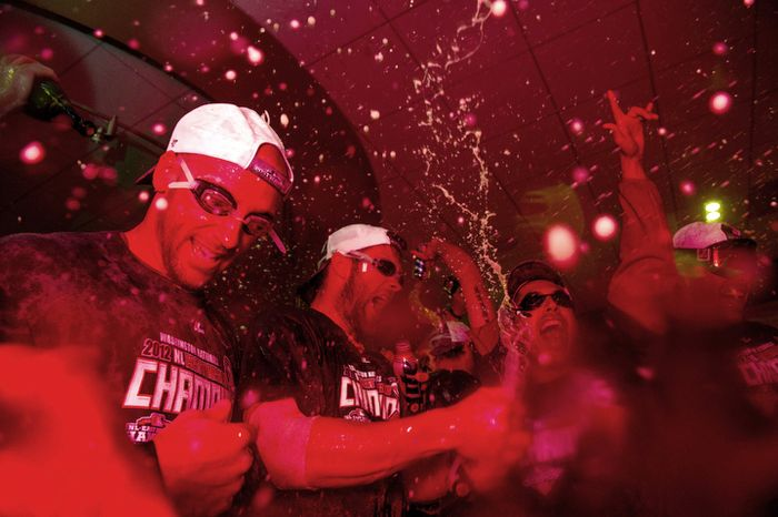 The Washington Nationals celebrate getting into the playoffs in their locker room at Nationals Park. (Andrew Harnik/The Washington Times)