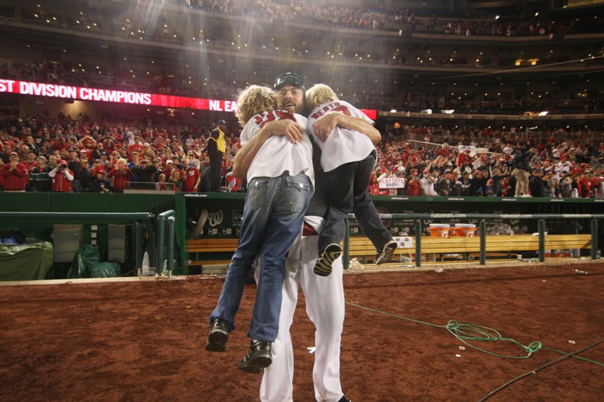 Washington Nationals right fielder Jayson Werth (28) celebrate after clinching division champ with a lose to the Philadelphia Phillies but win by Pittsburg Pirates over the Atlanta Braves at Nationals Ballpark, Washington, DC., Monday, October 1, 2012.(Craig Bisacre/The Washington Times)