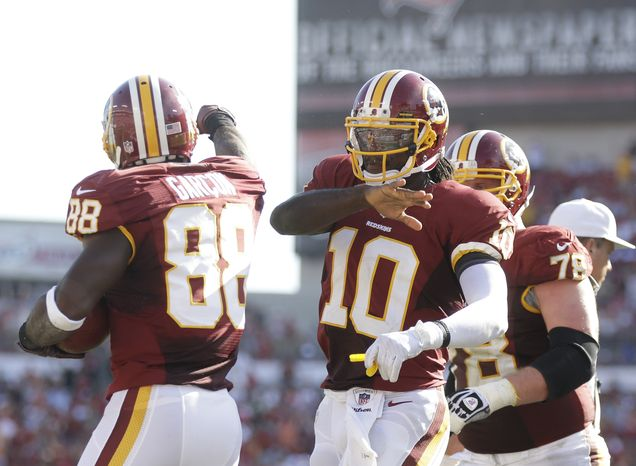 Washington Redskins quarterback Robert Griffin III (10) and Washington Redskins wide receiver Pierre Garcon (88) celebrate a touchdown in an NFL game against the Tampa Bay Buccaneers.  The Redskins defeated the Buccaneers 24-22 Sunday, Sept. 30, 2012, in Tampa, Fla.  (AP Photo/Margaret Bowles)