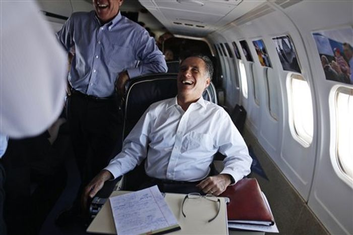 Republican presidential candidate and former Massachusetts Gov. Mitt Romney laughs as he talks with senior advisers on his campaign plane en route to Denver, Monday, Oct. 1, 2012. (AP Photo/Charles Dharapak)