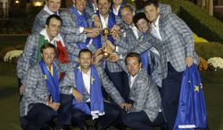 The European team poses with the trophy after winning the Ryder Cup PGA golf tournament Sunday, Sept. 30, 2012, at the Medinah Country Club in Medinah, Ill. (AP Photo/Chris Carlson)