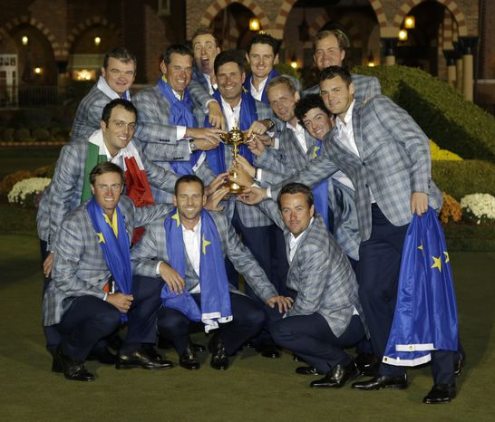 The European team poses with the trophy after winning the Ryder Cup PGA golf tournament Sunday, Sept. 30, 2012, at the Medinah Country Club in Medinah, Ill. (AP Photo/Chris Car