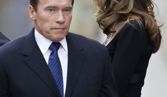 ** FILE ** Maria Shriver (right) and her husband, actor and former California Gov. Arnold Schwarzenegger, leave the funeral Mass for her father, R. Sargent Shriver, at Our Lady of Mercy Catholic Church in Potomac, Md., just outside Washington, on Saturday, Jan. 22, 2011. (AP Photo/J. Scott Applewhite)