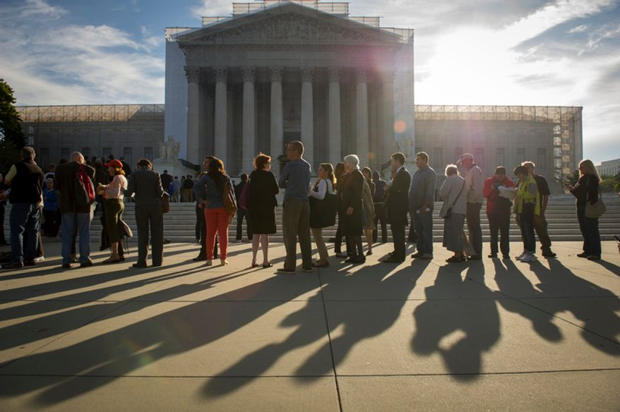 People wait in line to enter the Supreme Court on Oct. 1, 2012, before the justices return to the bench for another term. (Rod Lamkey Jr./The Washington Times)