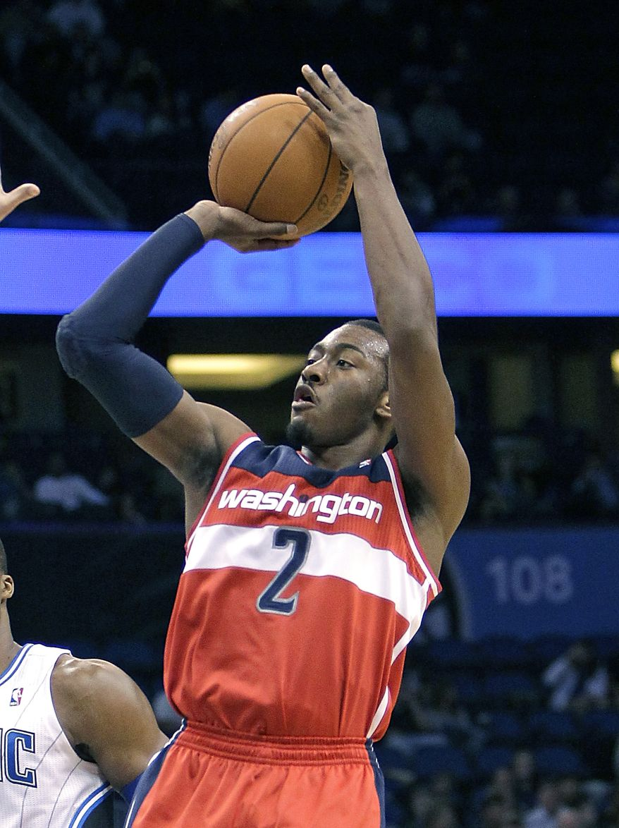 John Wall suffered a stress injury to his knee, and he's currently in his sixth week of recovery. (AP Photo/John Raoux, File)