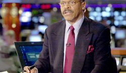 Bernard Shaw, the CNN anchorman famous for provocative questions to guests, talks with viewers on the CNN set in 2000. He joined the network in 1980 and retired in 2001. (Associated Press)