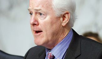 Sen. John Cornyn, Texas Republican, wants the Justice Department to release information on gunrunning operations in Texas and the source of guns in the 2011 killing of a U.S. agent. (Associated Press)