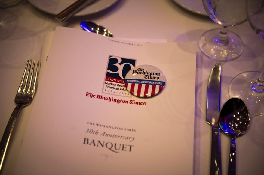 The dinner table is set for the evening banquet as part of the 30th anniversary celebration of The Washington Times at the Marriott Wardman Park Hotel in Washington, D.C., Tuesday, Oct. 2, 2012. (Rod Lamkey Jr./The Washington Times)
