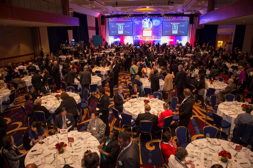People make their way into the ballroom for the evening banquet as part of the 30th anniversary celebration of The Washington Times at the Marriott Wardman Park Hotel in Washington, D.C., Tuesday, Oct. 2, 2012. (Rod Lamkey Jr./The Washington Times)