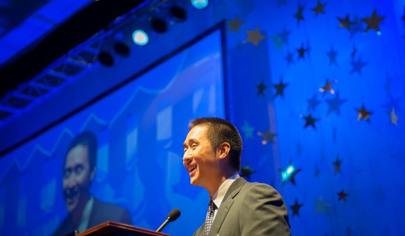 The Rev. Hyung Jin Moon, son of the Rev. Sun Myung Moon, delivers his speech to the crowd during the evening banquet as part of the 30th anniversary celebration of The Washington Times at the Marriott Wardman Park Hotel in Washington, D.C., Tuesday, Oct. 2, 2012. (Rod Lamkey Jr./The Washington Times)
