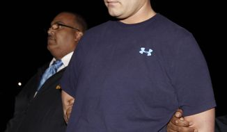 ** FILE ** Brian Downing is escorted by detectives for booking at police headquarters in New Orleans on Thursday, Jan. 19, 2012. Downing pleaded guilty to two counts of obscenity on Tuesday, Oct. 2, 2012, for sexually taunting an unconscious Louisiana State University fan in a Bourbon Street restaurant after the BCS national title game last January. (AP Photo/Gerald Herbert)