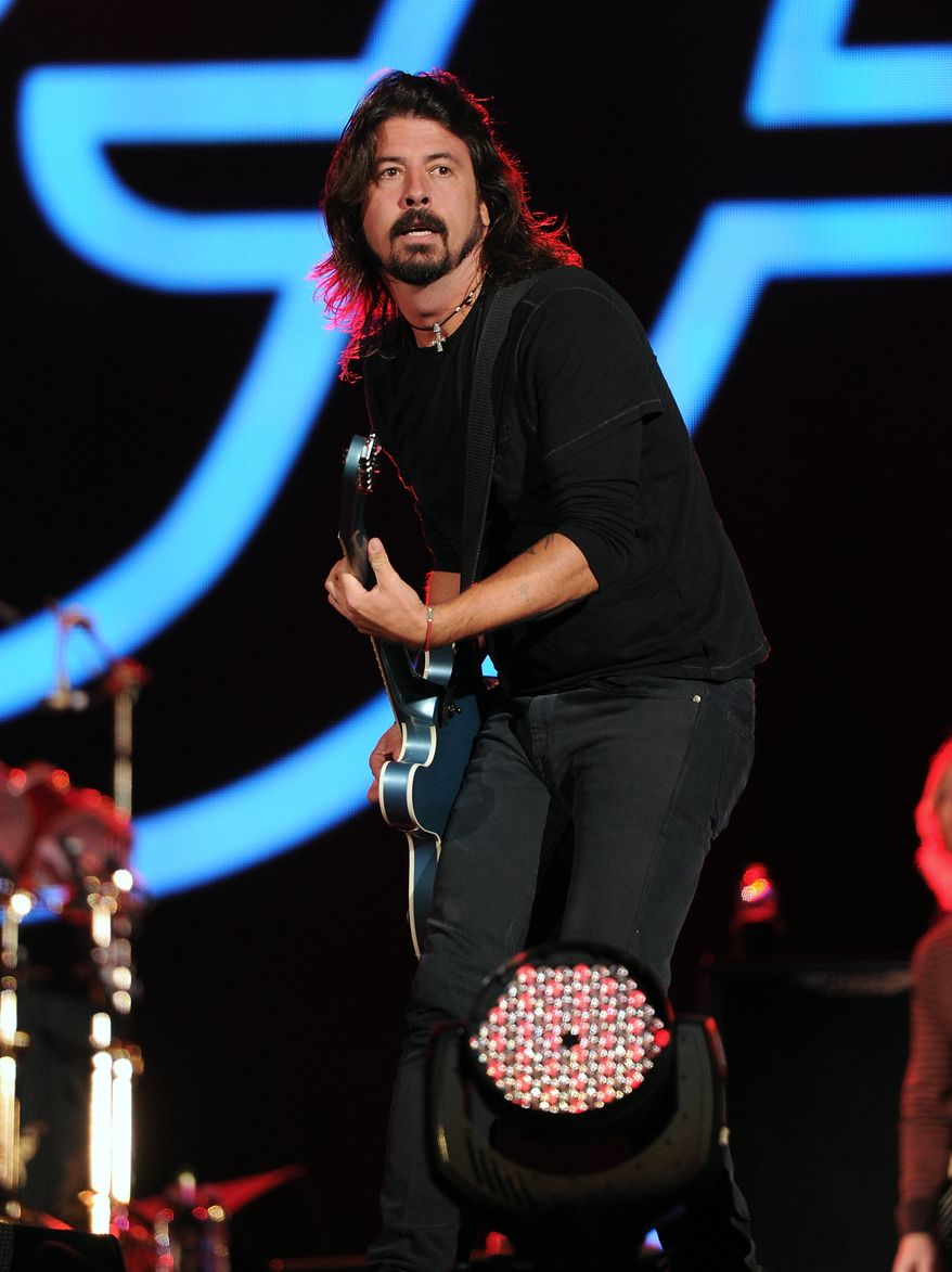 Dave Grohl performs with the Foo Fighters at the Global Citizen Festival in Central Park in New York on Saturday, Sept. 29, 2012, in New York. (Evan Agostini/Invision/AP)