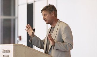 Gary Johnson, the Libertarian Party candidate for president, addresses an audience of students and the public at Macalester College, Friday, Sept. 21, 2012 in St. Paul, Minn. Johnson, a former two-term New Mexico governor, is on a nationwide college tour as part of his campaign for president. (AP Photo/Jim Mone)