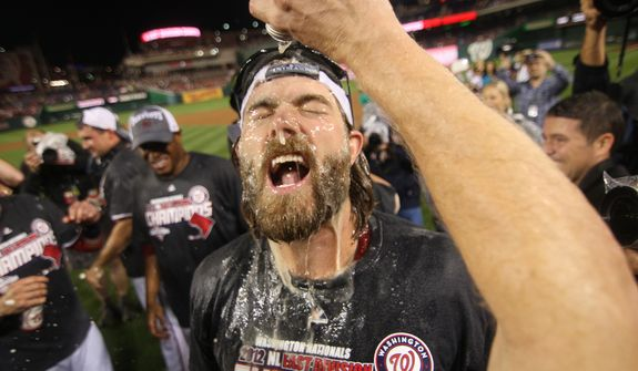 Washington Nationals right fielder Jayson Werth (28) has beer sprayed on him after the Washington Nationals clinching National League East, sending them into the playoffs at Nationals Ballpark, Washington, D.C., Monday, Oct. 1, 2012. (Craig Bisacre/The Washington Times)