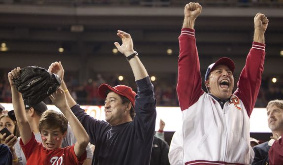 Fans celebrate after the Washington Nationals clinching National League East, sending them into the playoffs at Nationals Ballpark, Washington, DC., Monday, October 1, 2012.(Craig Bisacre/The Washington Times)
