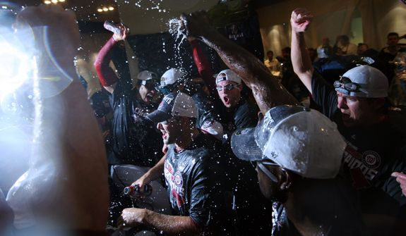 The Washington Nationals celebrate in their locker room after clinching National League East, sending them into the playoffs at Nationals Ballpark, Washington, DC., Monday, October 1, 2012.(Craig Bisacre/The Washington Times)