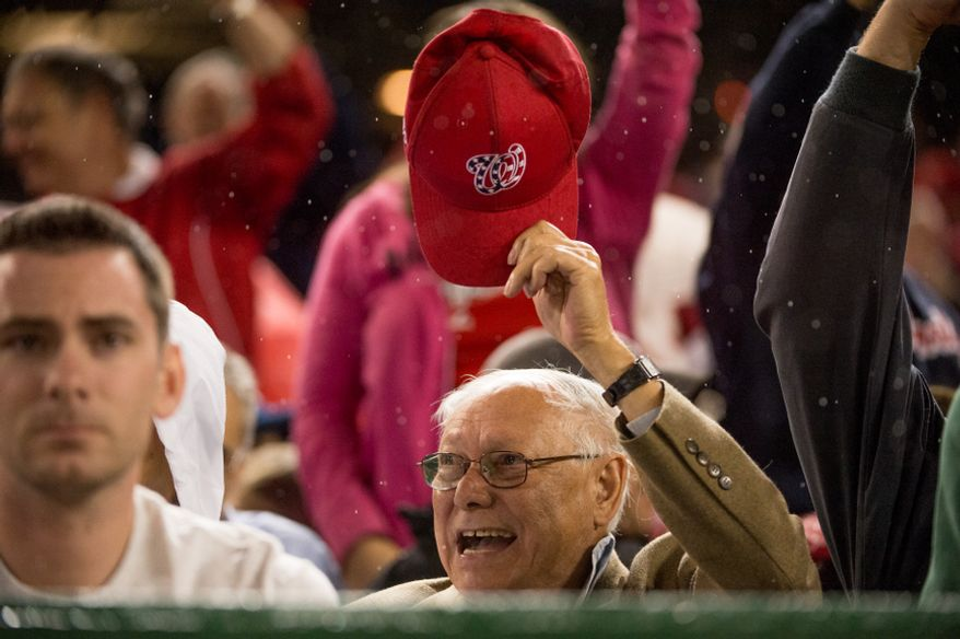 A fan holds up his hat as the Washington Nationals play the Philadelphia Phillies at Nationals Park, Washington, D.C., Monday, October 1, 2012. (Andrew Harnik/The Washington Times)