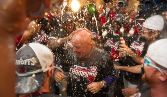 The Washington Nationals celebrate getting into the playoffs in their locker room at Nationals Park, Washington, D.C., Monday, October 1, 2012. (Andrew Harnik/The Washington Times)