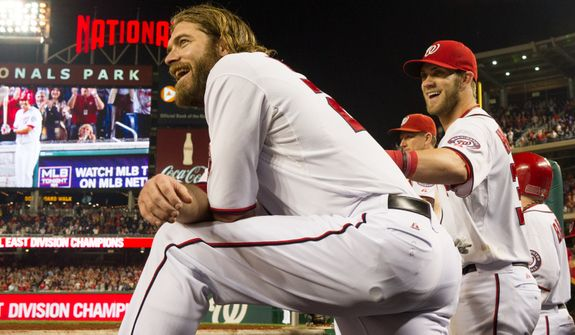 Washington Nationals right fielder Jayson Werth (28), left, and Washington Nationals center fielder Bryce Harper (34), right, smile as the Washington Nationals clinch the National League East at Nationals Park, sending them into the playoffs, Washington, D.C., Monday, October 1, 2012. (Andrew Harnik/The Washington Times)