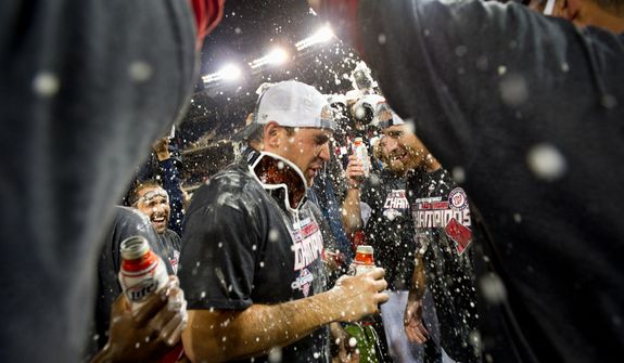 Washington Nationals third baseman Ryan Zimmerman (11), center, celebrates with his teammates as the Washington Nationals clinch the National League East at Nationals Park, sending them into the playoffs, Washington, D.C., Monday, October 1, 2012. (Andrew Harnik/The Washington Times)