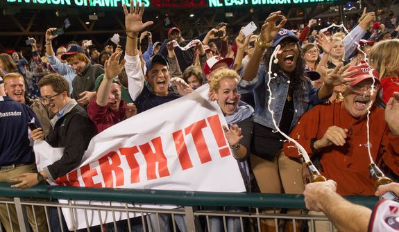 Washington Nationals right fielder Jayson Werth (28), right, throws beers on Washington Nationals fans in right field as the Washington Nationals clinch the National League East at Nationals Park, sending them into the playoffs, Washington, D.C., Monday, October 1, 2012. (Andrew Harnik/The Washington Times)
