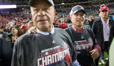 Nationals owners Ted and Mark Lerner take in the atmosphere after Washington clinched the National League East Division title at Nationals Park on Monday night. Ted Lerner became the managing principal owner of the franchise in May 2006. (Andrew Harnik/The Washington Times)
